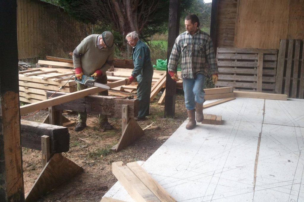 Ray, Colin and John cutting the timber
