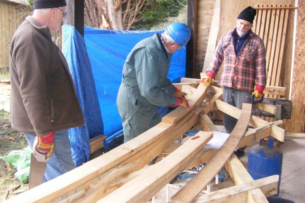 Les, Colin and Martin preparing to glue and screw